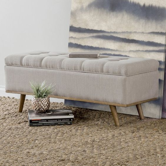 a cute fully upholstered bench or ottoman with a hidden storage space is great to add coziness to the entryway