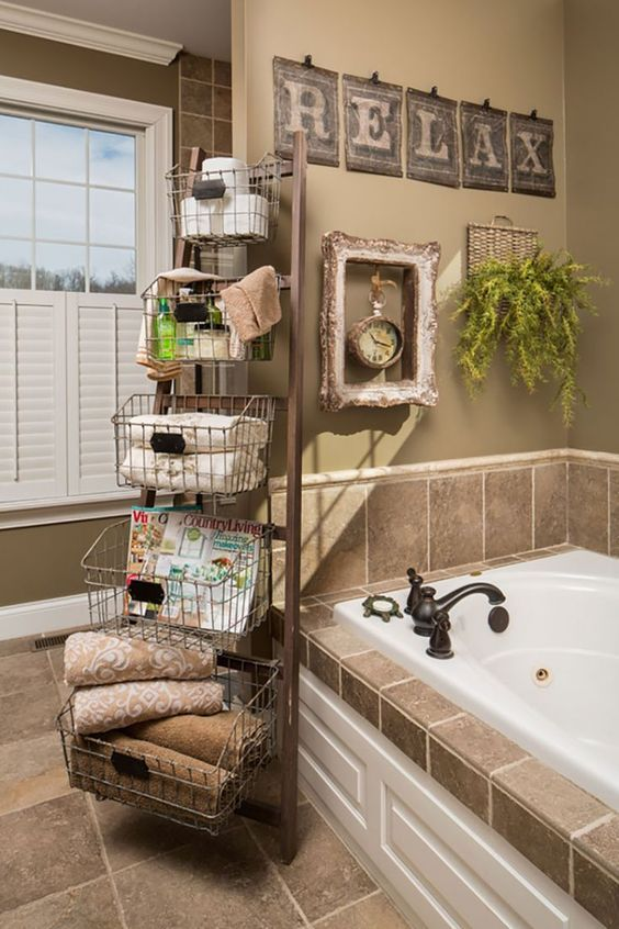 a ladder with wire baskets is a great idea that allows to accomodate a lot of things