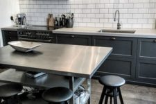 13 a metal kitchen island with two open shelves for storage can double as a breakfast space