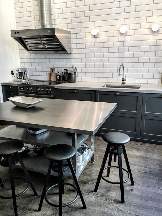 a metal kitchen island with two open shelves for storage can double as a breakfast space
