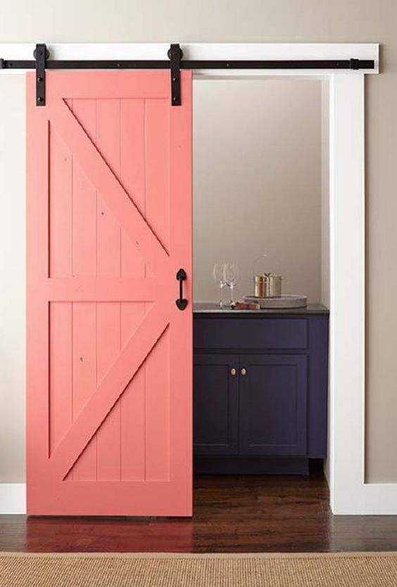 why not paint your barn door in some bold shades like coral to make a colorful statement in the interior