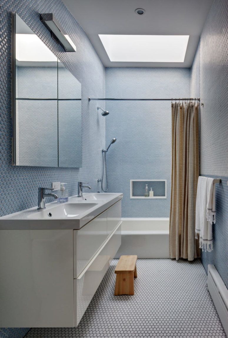The second bathroom is done with peaceful light blue penny tiles, it's very relaxing