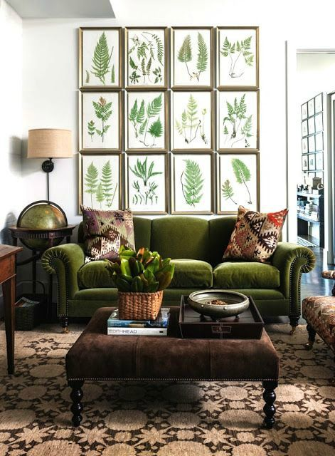 a combo of green velvet, greenery gallery wall and browns makes this space feel natural and welcoming