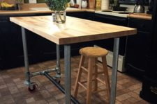 14 a portable industrial kitchen island of metal pipes on casters and a butcher block as a top can be DIYed by you