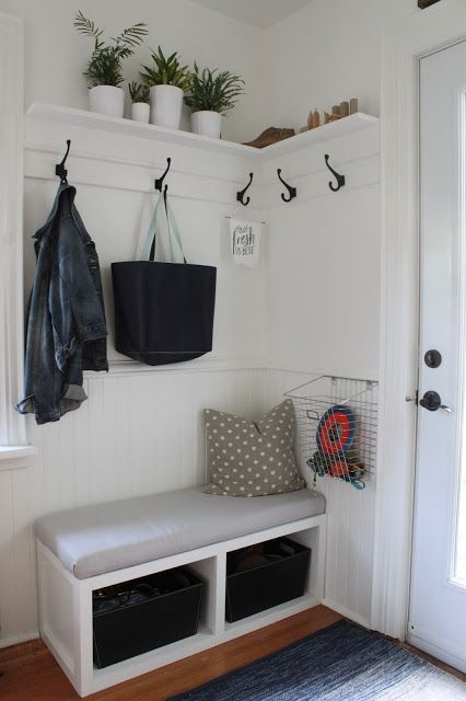 a small bench with drawers inside is ideal for a tiny entryway to rock