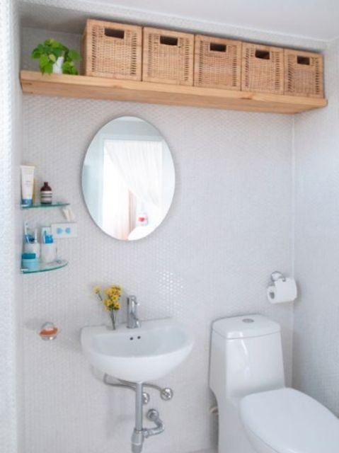 a bathroom shelf with woven basket drawers is a creative and easy idea