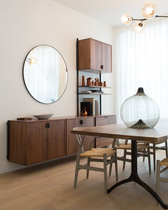 a floating credenza and additional cabinets take wall space no floor space