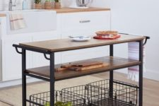 15 a portable kitchen island of blackened metal, casters and some wooden tops plus two shelves for comfy storage