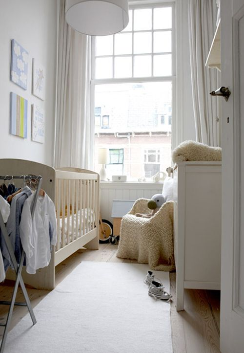a window takes a whole wall and there's a pendant lamp to make the nursery lighter