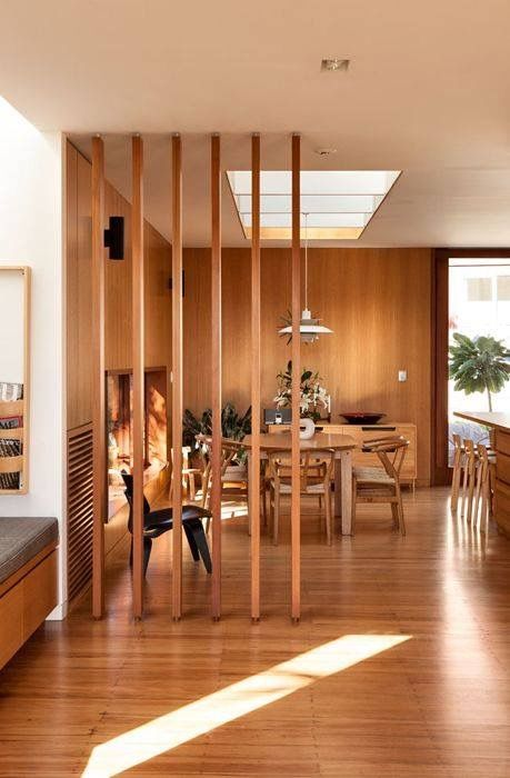 such a slight wood room divider is great to gently hint on the separation of the living and dining rooms