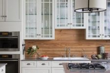 15 traditional white cabinets are warmed up with a light-colored wood backsplash