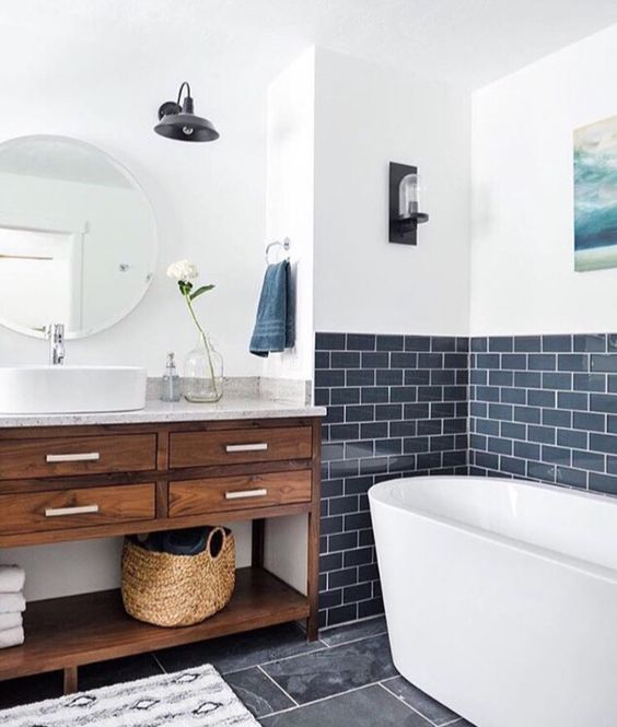 a contemporary bathroom with a navy tile backsplash with white grout for a chic touch