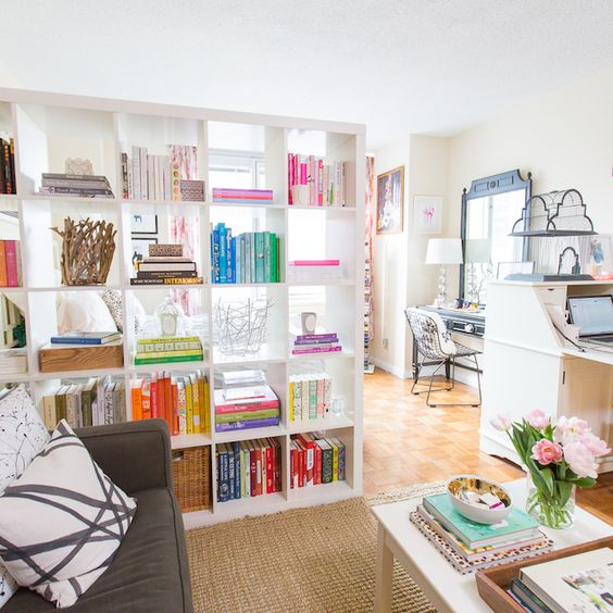 a large white shelving unit is always a great piece for separating any spaces as it will easily fit any modern ambience