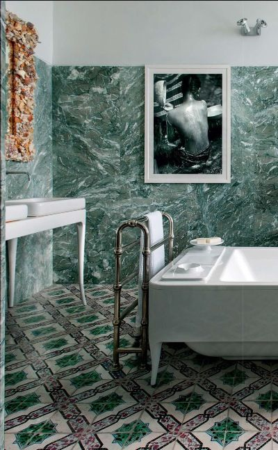 green marble tiles on the walls and mosaic tiles on the floor for a bold eclectic look