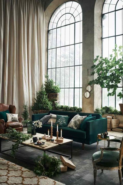 much greenery and green furniture enliven this industrial space and make it vivacious