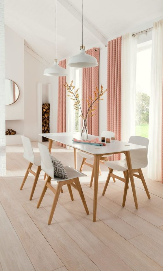 Pink printed and white grommet curtains for a soft colorful touch and a cozy look in the dining room