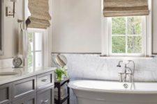 17 a simple marble tile backsplash adds chic to a modern farmhouse bathroom