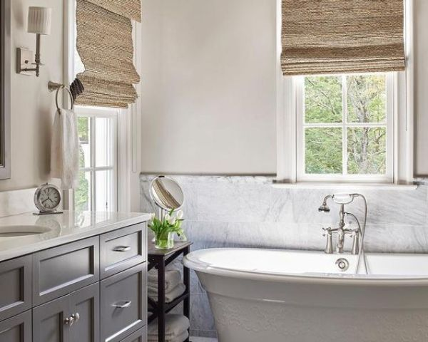 a simple marble tile backsplash adds chic to a modern farmhouse bathroom