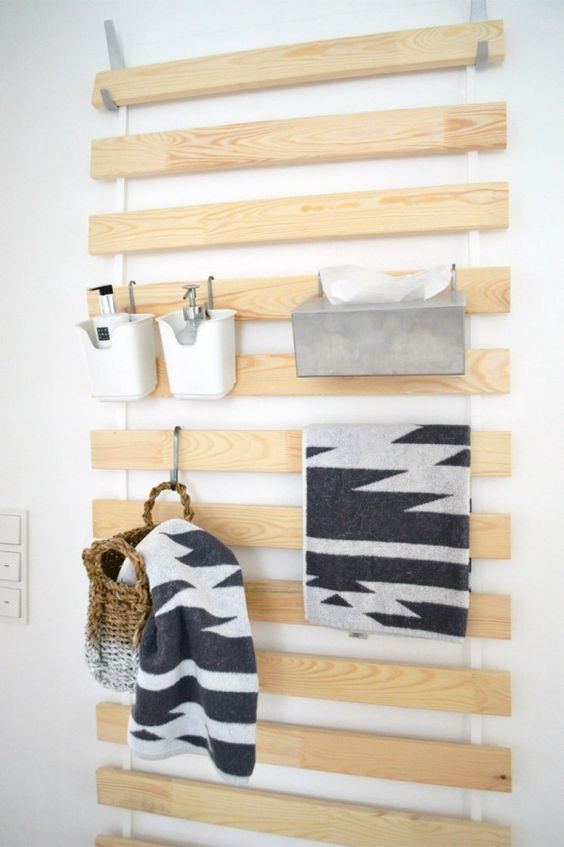 a smart IKEA hack to hold various supplies, towels and some baskets and caddies