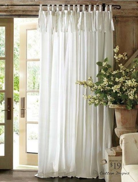 An ethereal tab-top white curtain is an ideal piece for a French countryside space