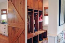 18 a light-colored sliding barn door can be used to hide a small mudroom or another functional space