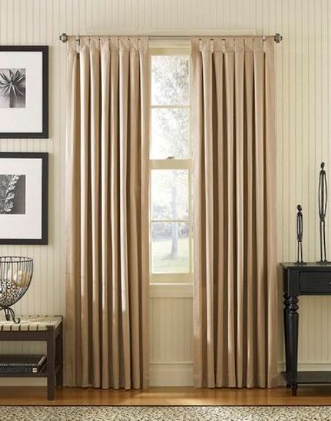 Tab-top curtains can also look more dressed up if you choose proper fabric or decorative loops and rods