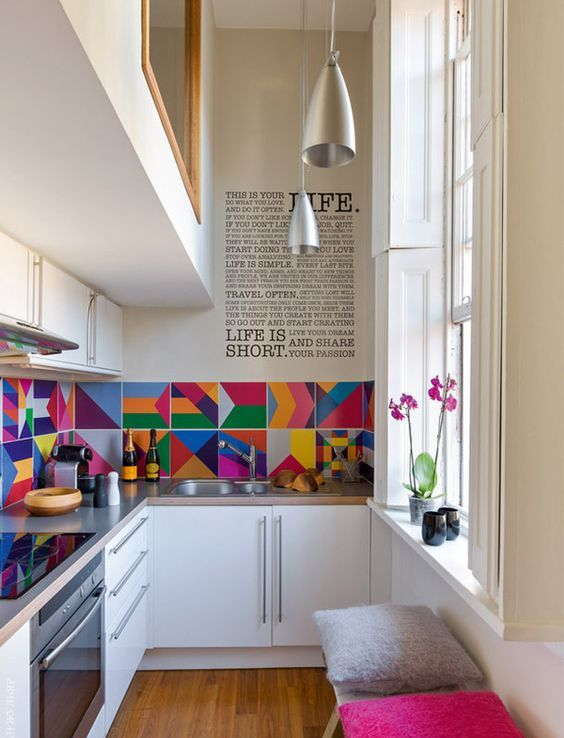 a colorful tile backsplash changes the space and makes it vivacious and welcoming