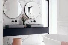 19 a gorgeous marble accent wall and bathtub platform make the space peaceful and refined