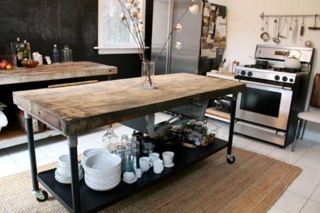 a table with metal legs and a shelf on casters and a reclaimed wooden tabletop can be used as a table, too