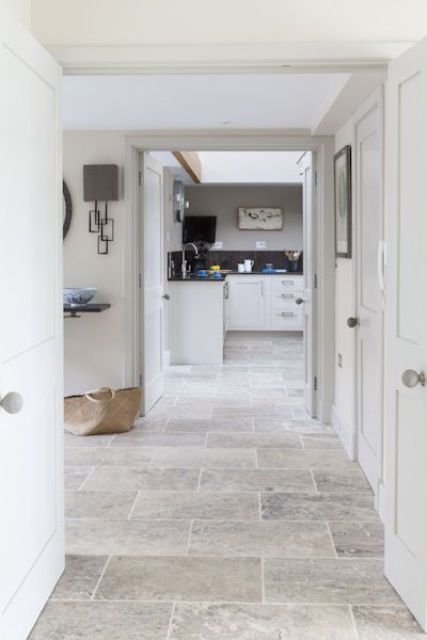 stone flooring is a bold statement with the material and it's a very durable option for any space