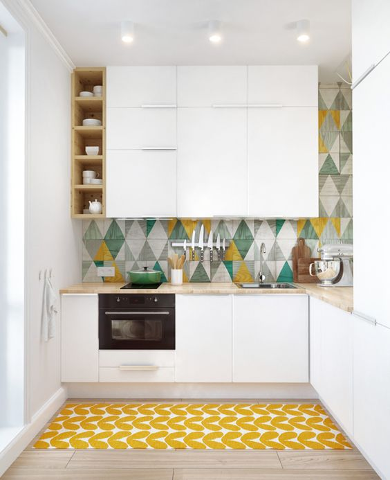 a colorful tile backsplash and a bold printed rug make the kitchen more eye-catchy and welcoming