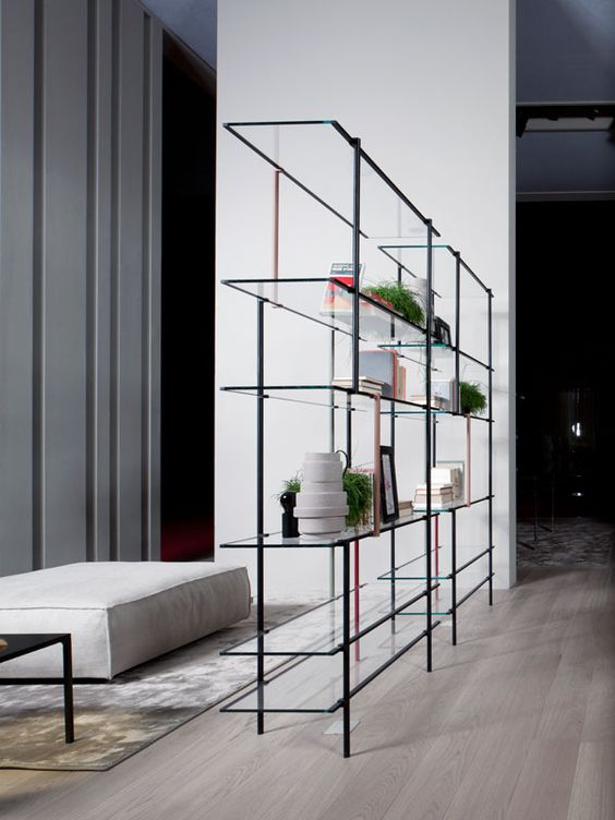 a very ethereal shelf of metal and glass doesn't offer much privacy but doesn't look bulky and lets all the lights through