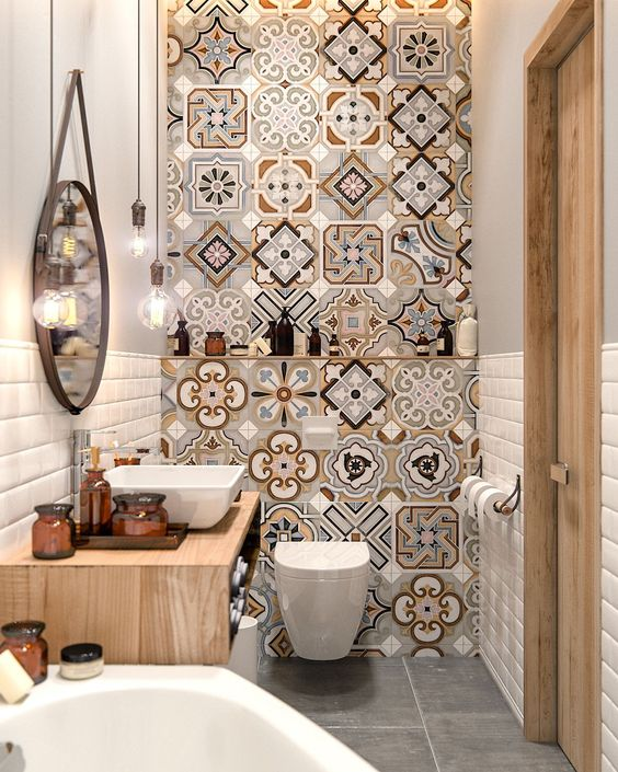 an accent mosaic wall changes the whole look of this very small bathroom