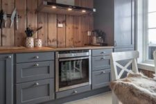 20 graphite grey vintage-looking cabinets are softened and warmed up with light-colored wood