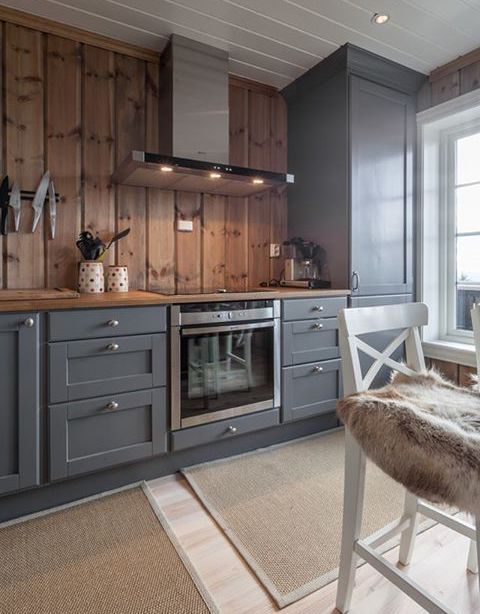 graphite grey vintage-looking cabinets are softened and warmed up with light-colored wood