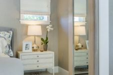 21 a light-colored barn door with a large mirror can be used for dressing up in the bedroom
