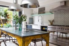 21 a vintage industrial kitchen island and table with a metal tabletop and vintage shabby legs
