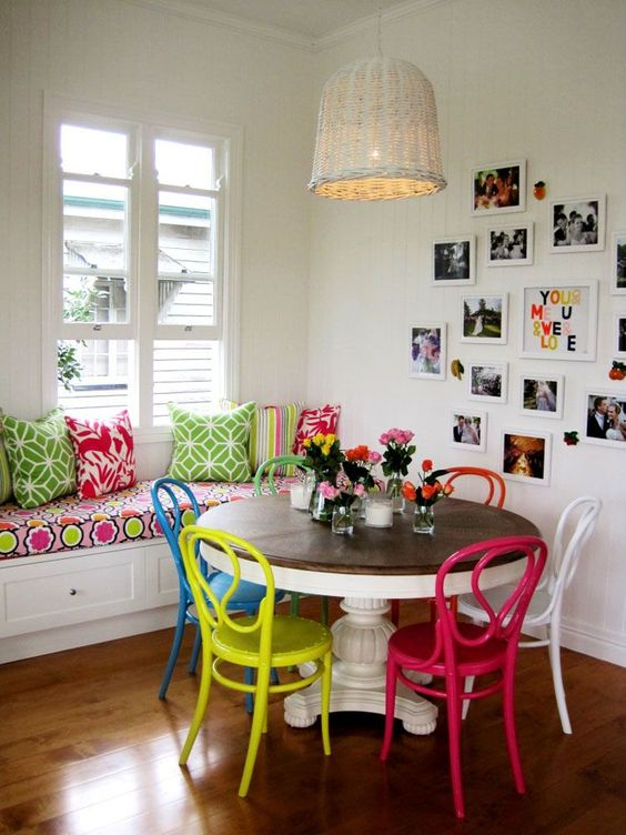 a vintage rustic dining table plus same chairs but in different bold colors to rock