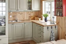 21 rustic vintage off-white cabinets, light-colored wooden countertops and backsplashes for a welcoming feel