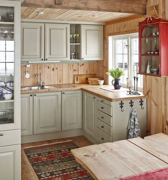 rustic vintage off-white cabinets, light-colored wooden countertops and backsplashes for a welcoming feel