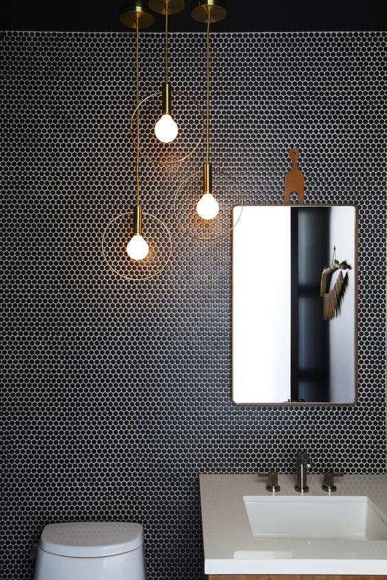 trendy black penny tiles with white grout to stand out plus gorgeous pendant lights