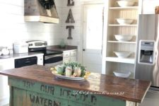 22 a vintage industrial kitchen island of wood with a green base of crates that looks very eye-catchy