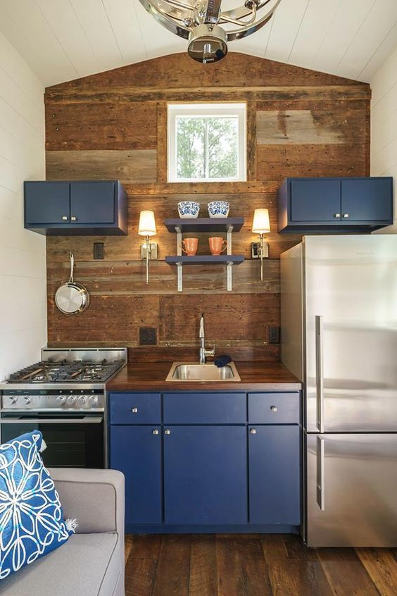 even a small nook can get some color with bold cabinets like these blue ones, for example
