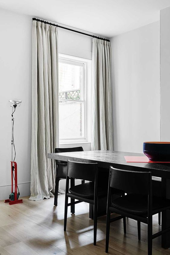 Add a casual feel to the space with textural curtains and pencil pleat