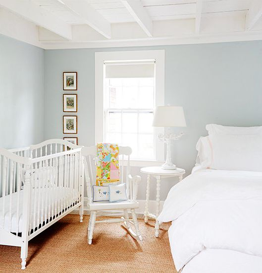a peaceful shared space with white vintage furniture and a comfy pastel color palette