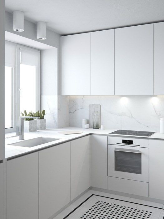 a pure white minimalist kitchen is made more catchy with marble surfaces