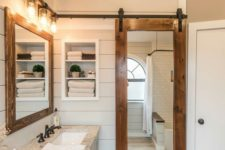 23 a sliding barn door with a mirror insert is a great idea for the bathroom as the mirror is a must for such a space