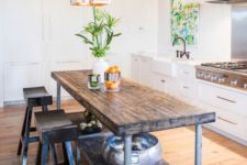 23 a vintage industrial kitchen island shaped as a table with an additional shelf can function as a breakfast table, too