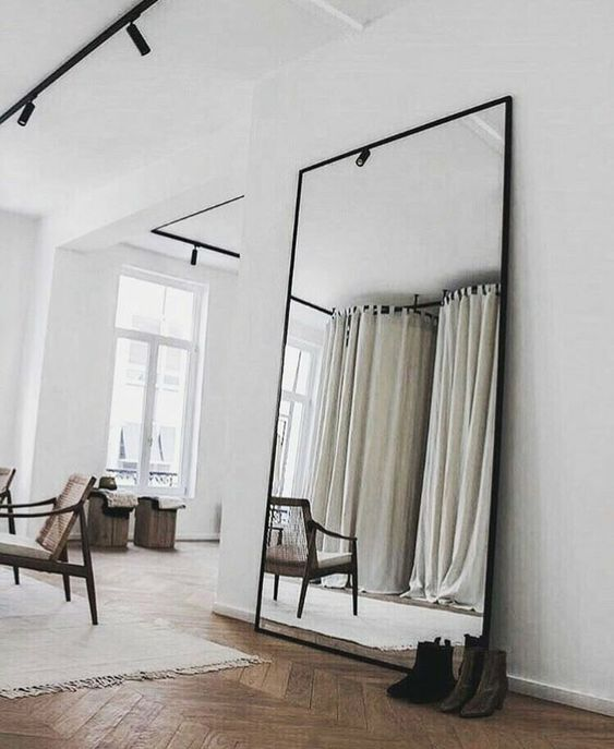 an oversized vertical floor mirror will add visual height, can be used for dressing up and will visually enlarge the space