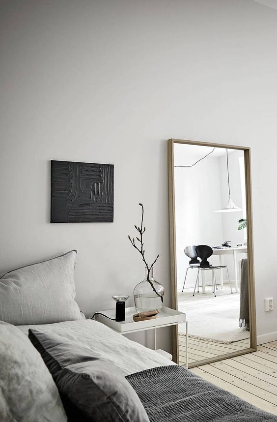 a simple vertical mirror in a wooden frame is always a good idea and it will fulfill many functions